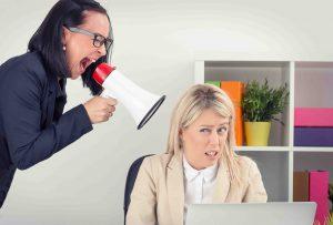 Boss yelling atemployee onmegaphone