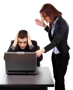 Angry businesswoman showing her emplyee the mistakes ona laptop