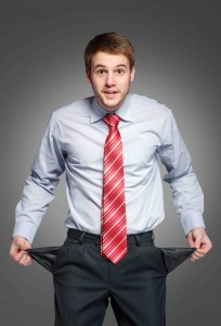 businessman showing his empty pocket, turning his pocket inside out, concept no money.